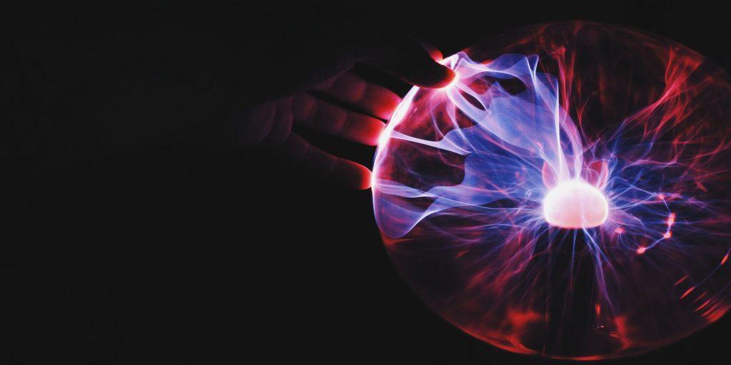 modern world technology holding ball