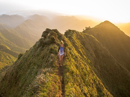 woman hiking on top of mountain